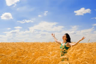 Women Love to Stand in Wheat Fields Facing the Sun with Their Arms Outstretched